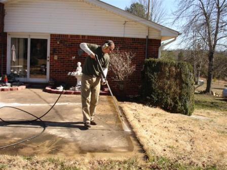 pressure washing a concrete patio